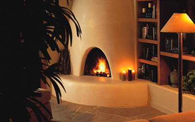 New Mexico adobe fireplace